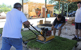 Compacting the turf to test Living Soft Fall's ™ softness in different conditions