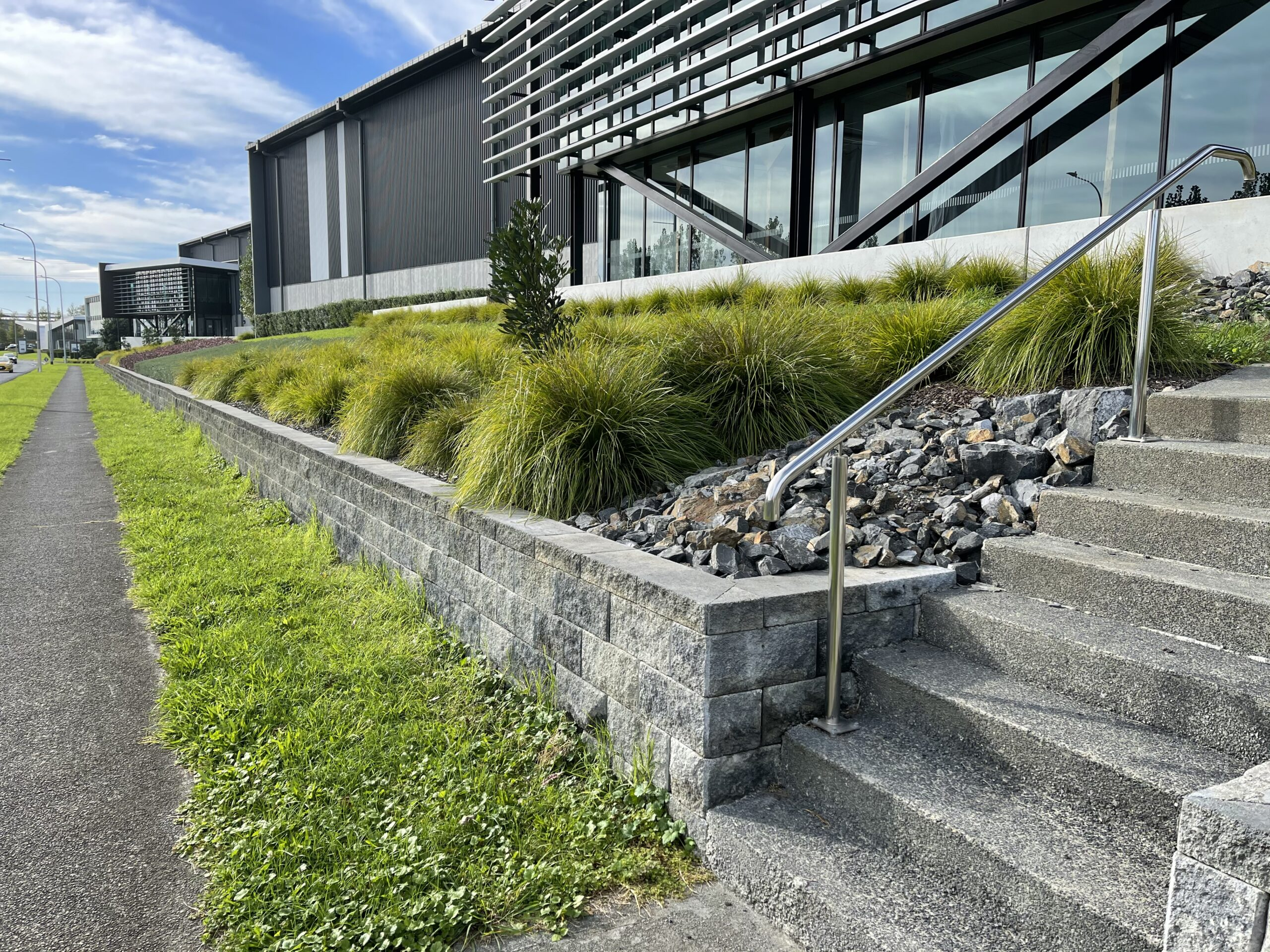 Tanika® Lomandra planting and gravel areas used to reduce run-off on a slope